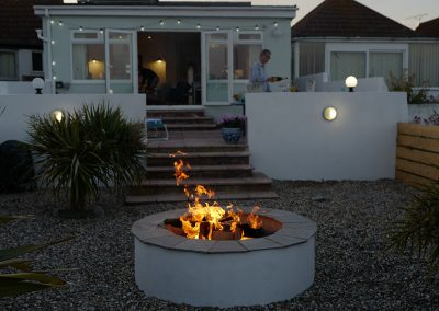 A fire pit makes the garden glow