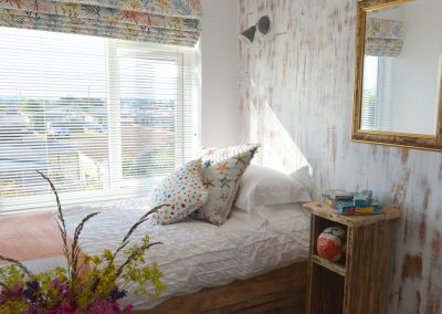 Twin bedded room with hand made beds